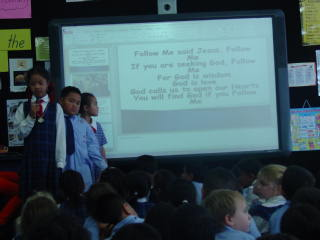 We can all read the words on the ActivBoard. Mrs Lucre changes the pages on the PowerPoint for us.