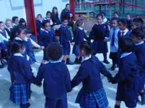 Holding hands the children walk clockwise round the circle.