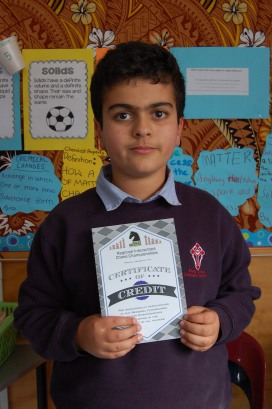 Edmon with his Chess certificate