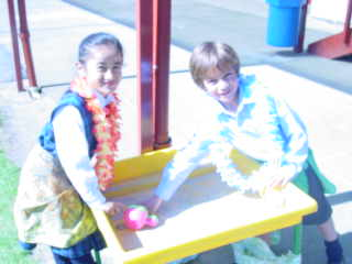 We can play in the sand tray in our lavalava.