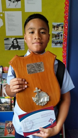Teofilo Falanai with the Catholic Character award