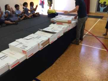 Look at all the boxes of books Holy Cross Catholic School pupils we about to receive!