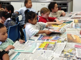 We put newspaper on the tables to keep them clean - and folded another piece each to mix our paints on.
