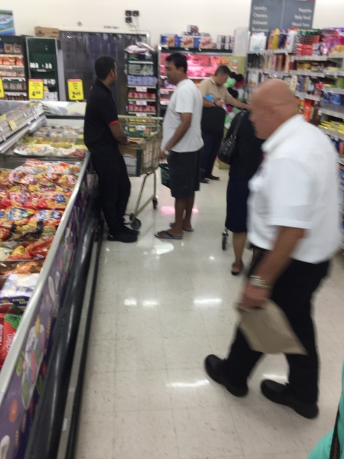 Customers compare prices and choices of goods