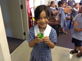 Imogen is happy with her green jelly, it smells so good and she can't wait to eat it!