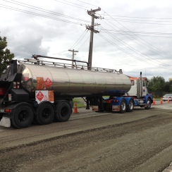 This tanker holds liquid to mix wiht the gravel as it goes on the road.