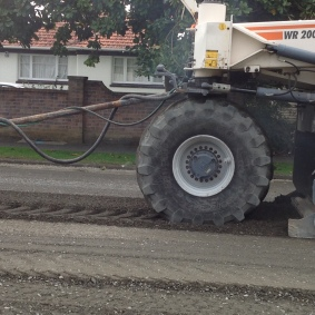 See how the big tyres are leaving prints in the gravel mix.