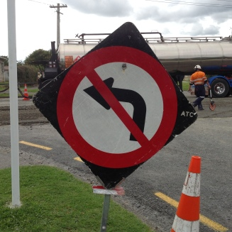 """No left turn!' Signs help drivers keep safe around road works."