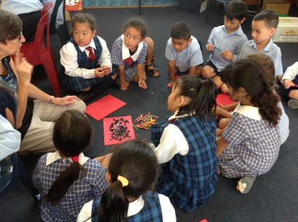 Half of the class stayed on the mat and chose the items they needed for their poppy.