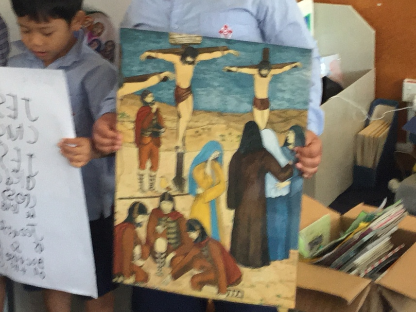 The poster shows Jesus nailed to the cross.