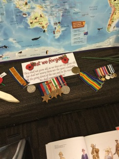 A display of medals with bright coloured ribbons