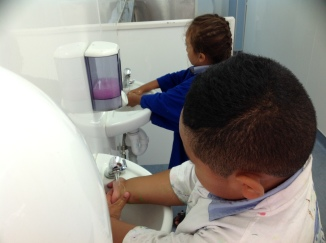 Boys cleaning their hands