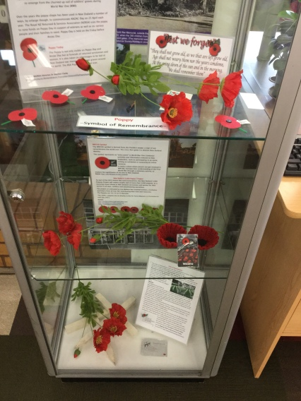Silk, paper and knitted poppies