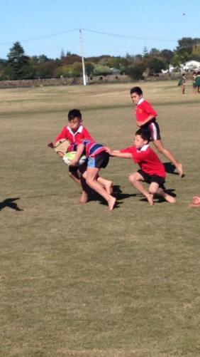 Watene running the ball.