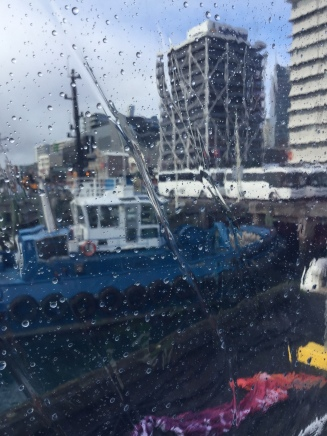 Through the windows we see a tug boat