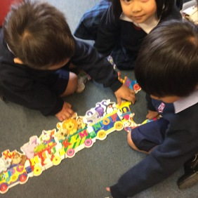 They are taking turns to place pieces.