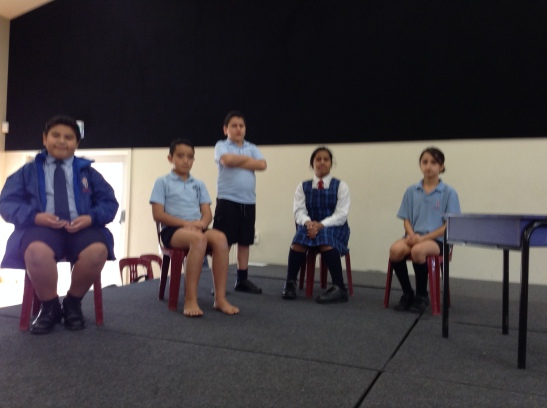 Room 17 acting our a scene from parliament.