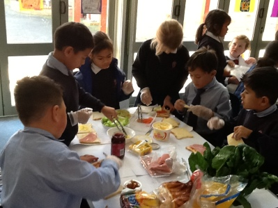 We are making healthy sandwiches for our lunch and they taste yummy.