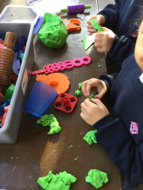 Cutting out playdough shapes