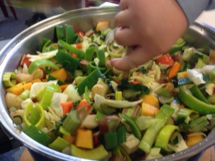 All of the vegetables in the pot, ready to cook.