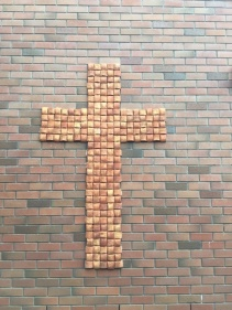 A ceramic cross outside Room 9