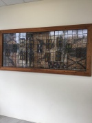 A stained glass plaque