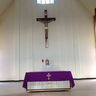 The crucifix above the altar