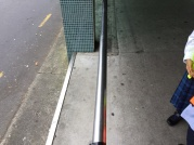 A hand rail up the ramp to the shops